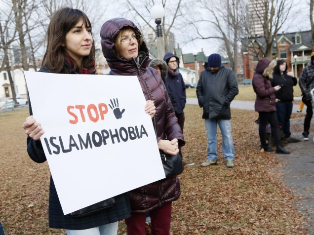 Protestors hold signs at a protest against Islamophobia at Dundonald Park in Ottawa on Sunday, December 13, 2015. (Patrick Doyle / Ottawa Citizen) ORG XMIT: 1213 Islamophobia07